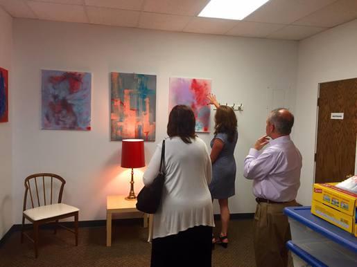People viewing paintings